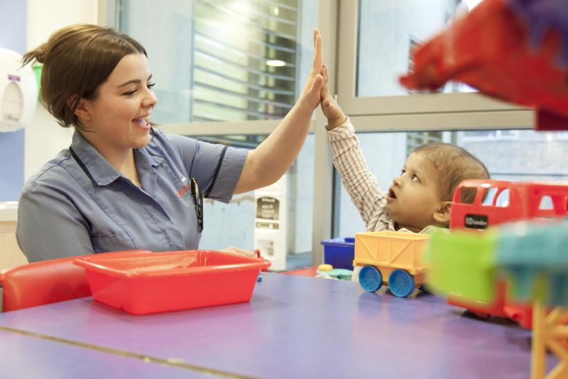 Abdulrahman enjoying time with his nurse in Butterfly Ward playroom