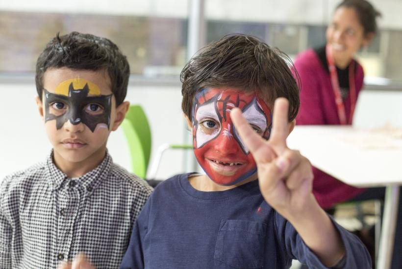 Two boys posing with facepaint