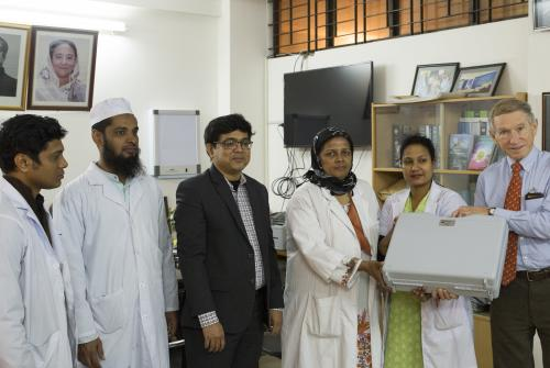 Brian giving the Dhaka team an endoscope donated by CLEFT